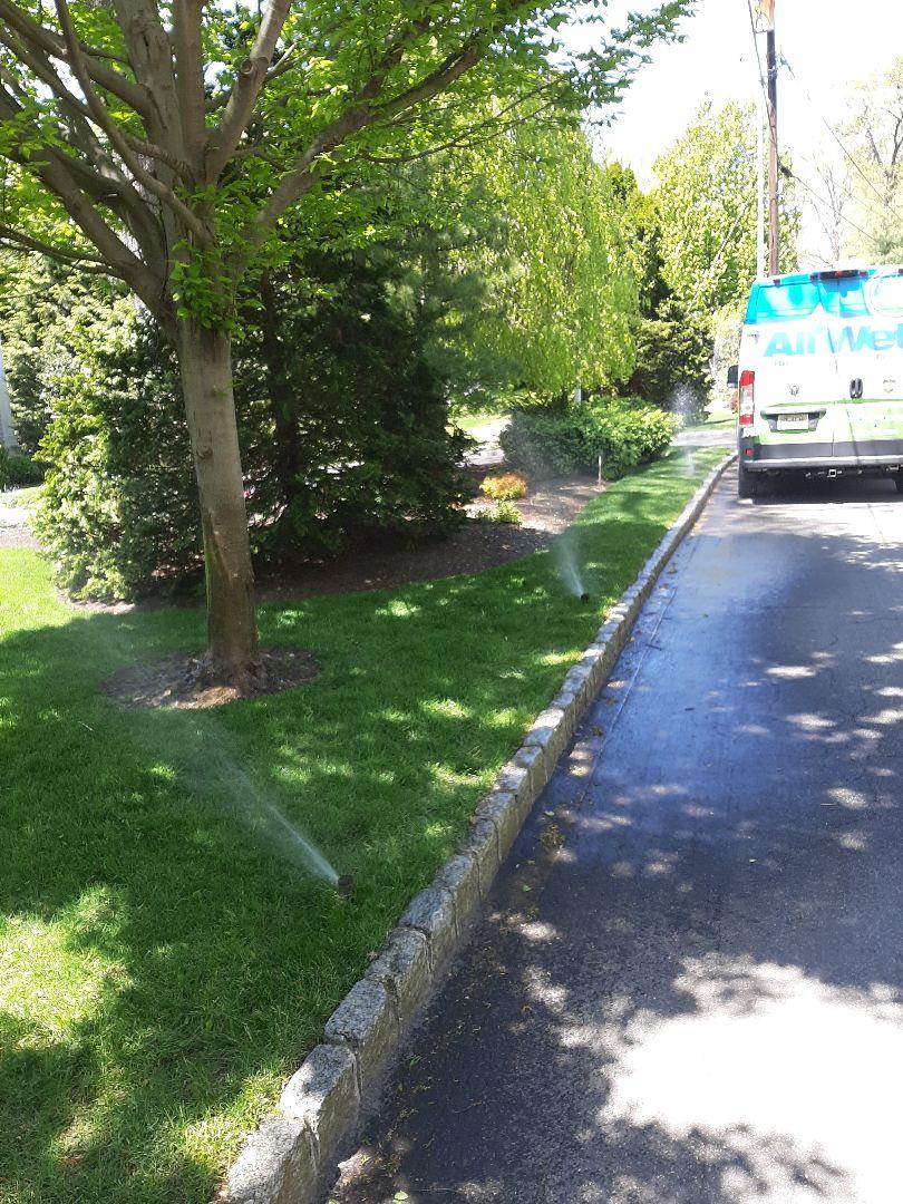 Summit, NJ - Spring start-up, irrigation sprinkler turn on. In Summit NJ
