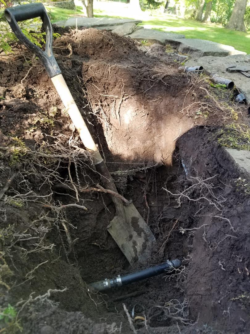 Fixing irrigation sprinkler leak rerouting pipe