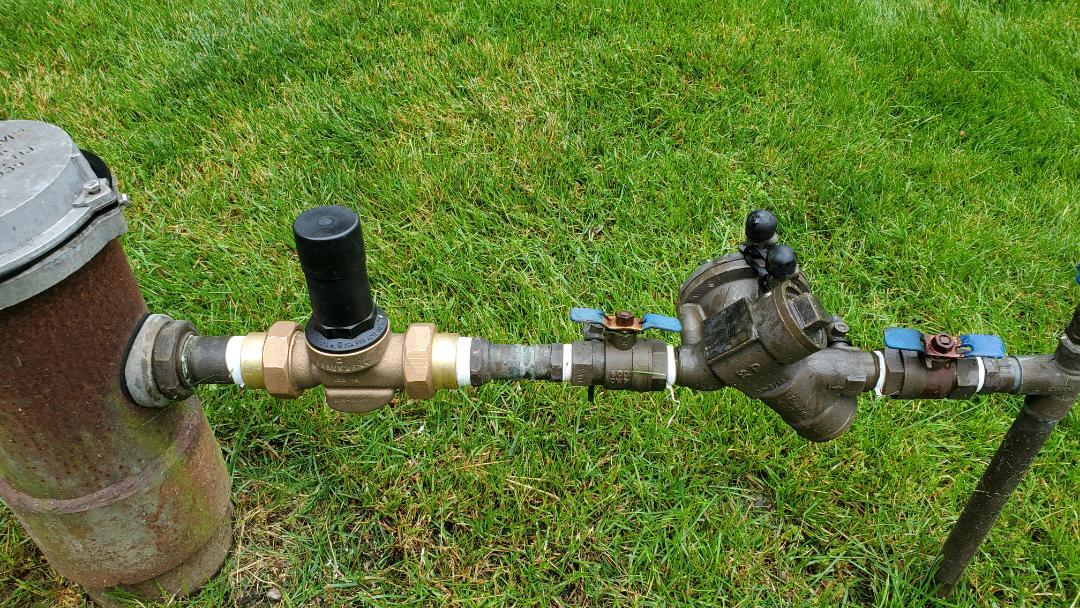Install new pressure regulator on well sprinkler system