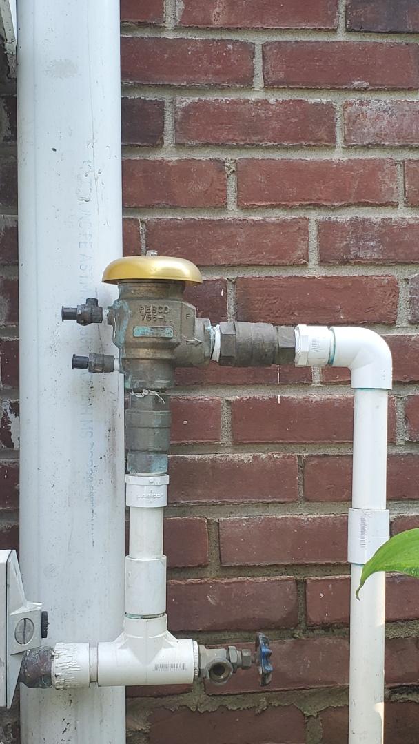 Test backflow and add master valve to sprinkler system