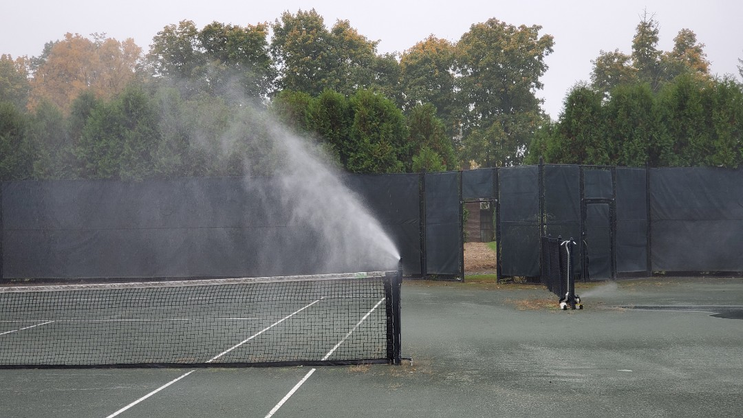 Blow out sprinkler system at a country club tennis court