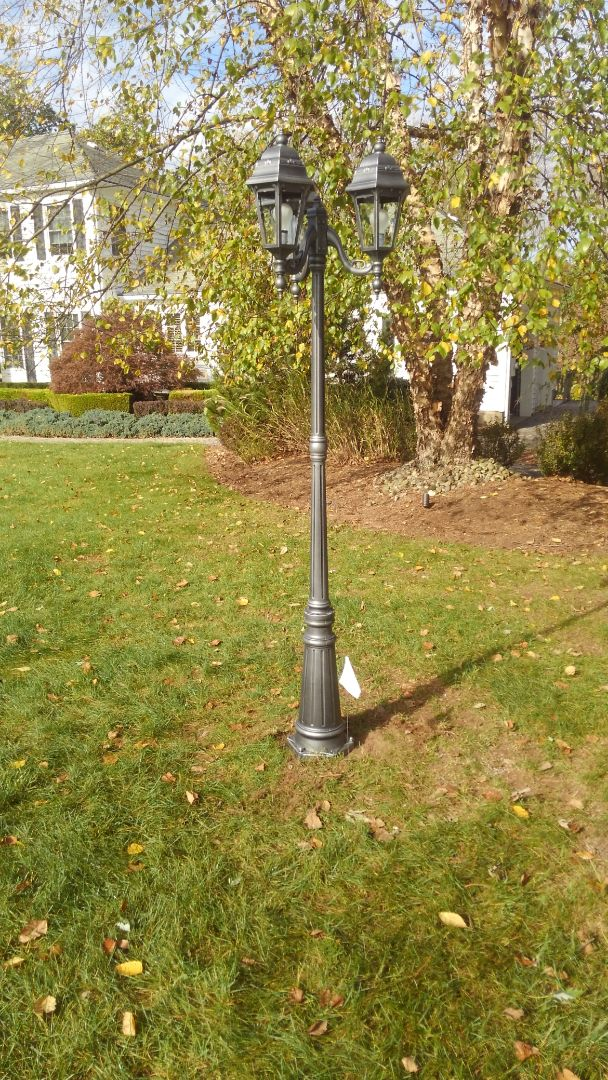 Low voltage lighting installed with new lamp post provided by home owner