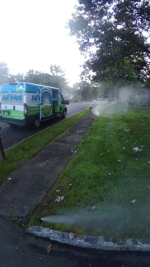 West Caldwell, NJ - Blowing out sprinkler system