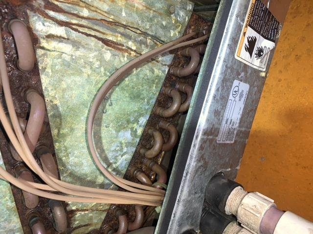 Roanoke, TX - Discovered a leaking evaporator coil on this Carrier ac unit in Roanoke