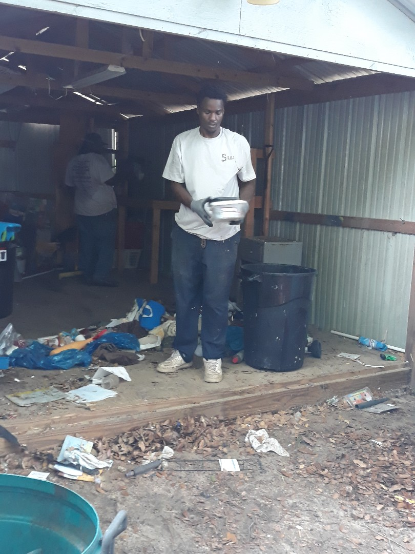 Cain at work cleaning out a shed hauling the junk and removing all the trash here in Crestview