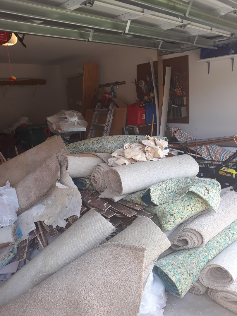 Navarre, FL - Tile removal and carpet and other trash removal from a customer home