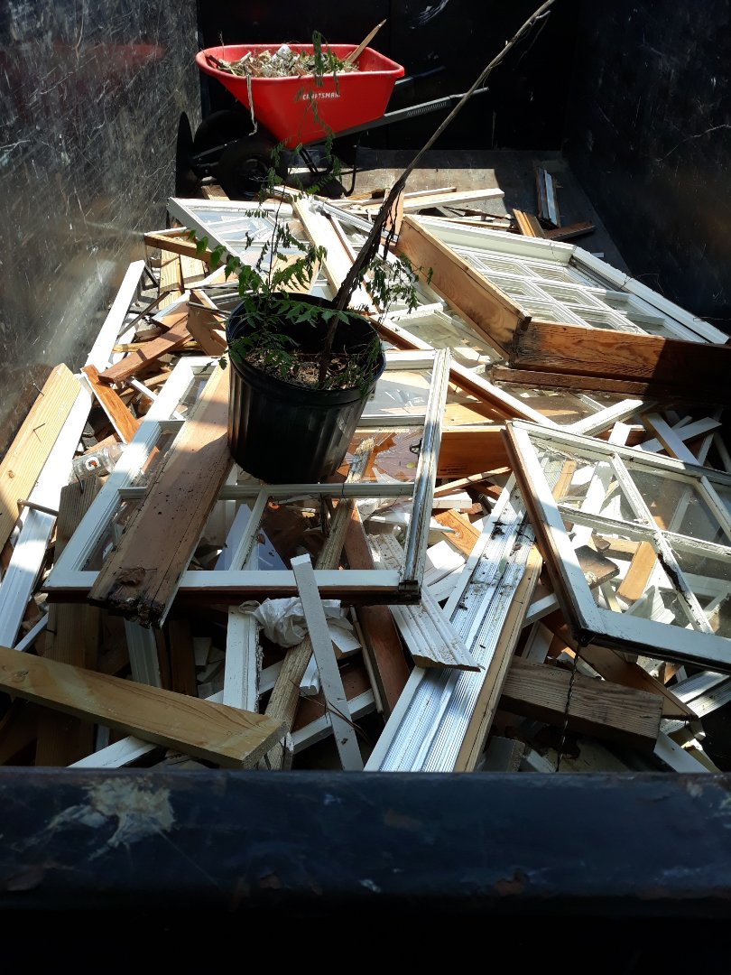 Remove windows and old wood and trash debris from customer yard today.