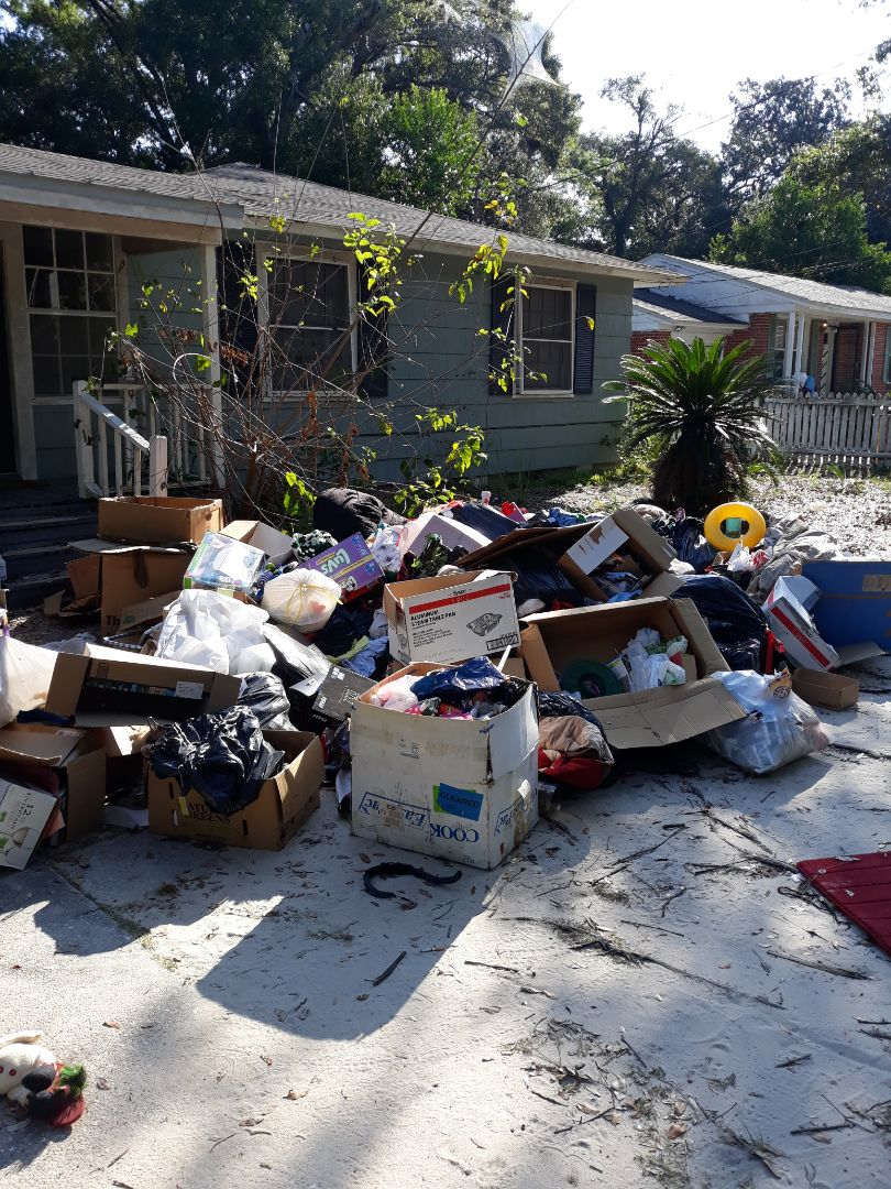Remove trash and debris from a customer yard
