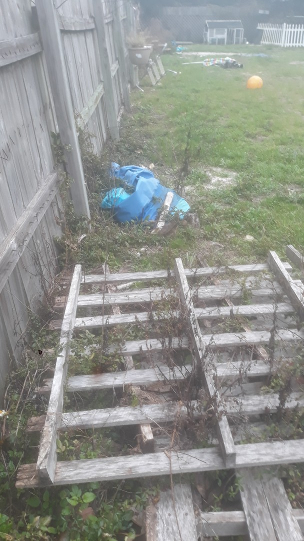 Yard and house clean out for client putting rental on market. Also demo of shed and rotted wood on garden bed in a large backyard in Gulf Breeze.
