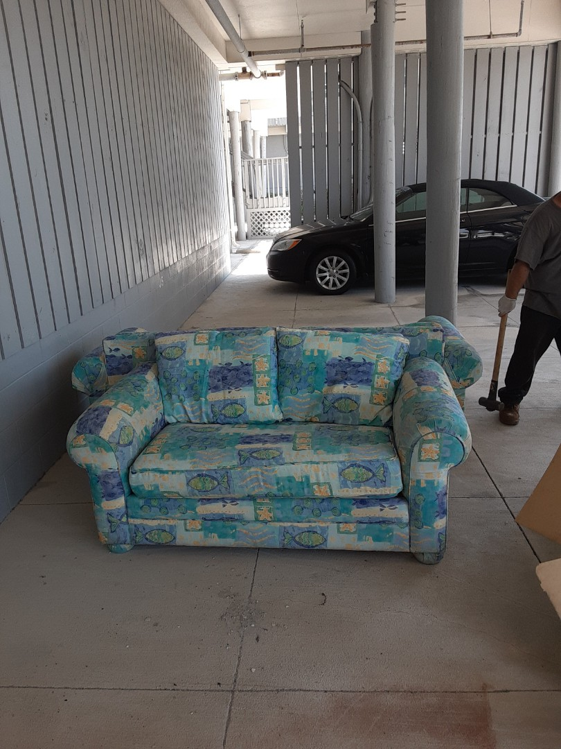 Pick up 2 couch and a entertain center for a customer on the beach
