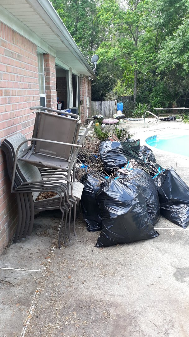 Remove trash and debris from customer backyard today