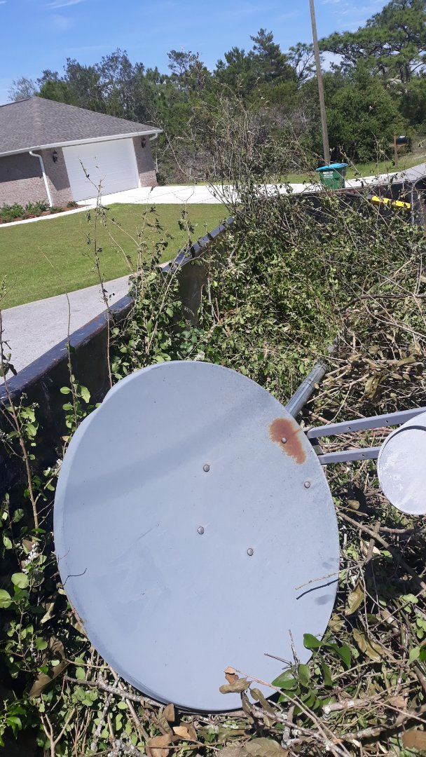 Remove old satellite dish for customer here in Gulf Breeze Florida