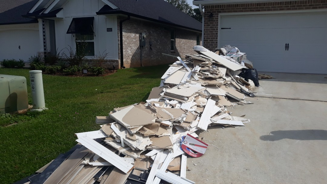 We are removing sheetrock and other debris from customer's driveway today here in Pace Florida