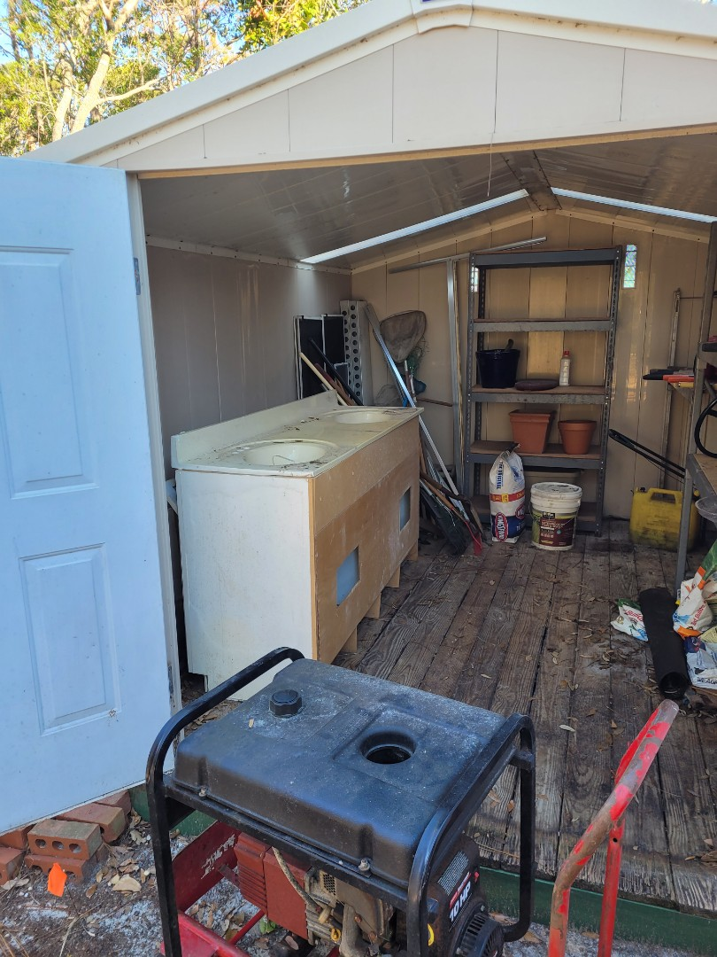 Remove all cabinet and other trash out a customer's shed today