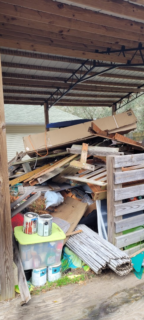 Go a call to remove trash and debris from customer backyard