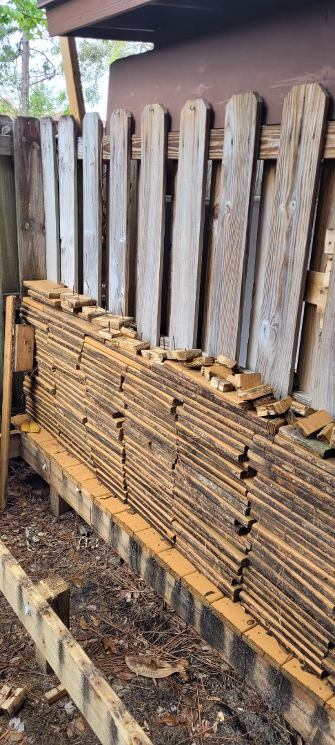Remove old decking and other trash debris from customer backyard