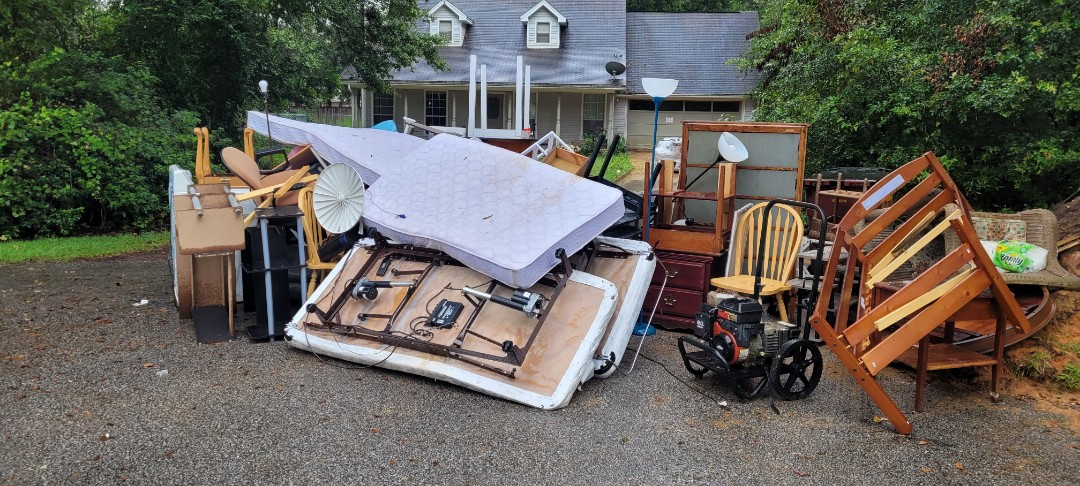 Go a call to removes all this furniture and trash in front of customer home