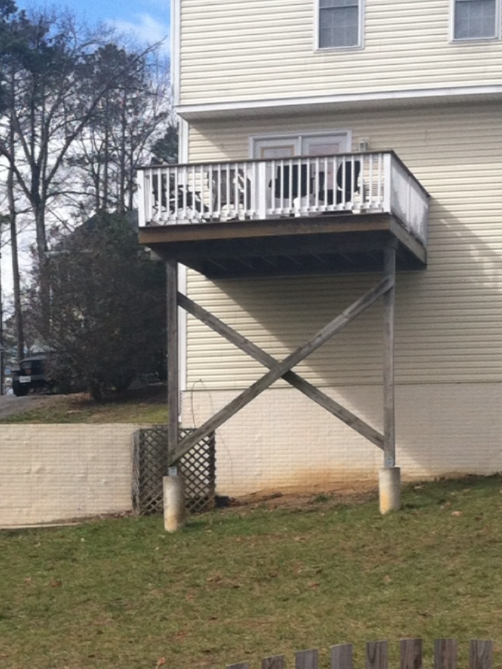 Chesterfield, VA - 2 story deck sitting on concrete posts on TOP of and not IN the ground. NOT GOOD.