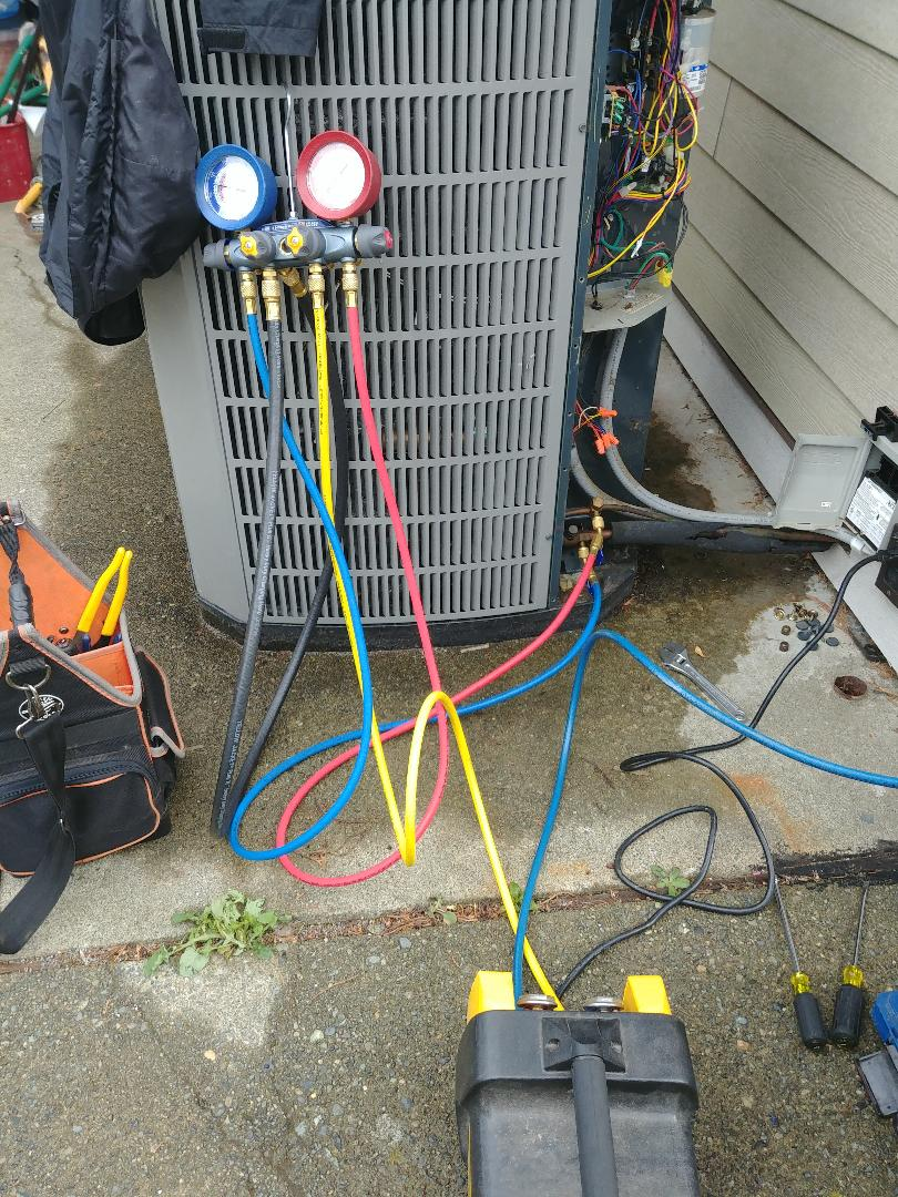 Recovering refrigerant to replace a high pressure switch