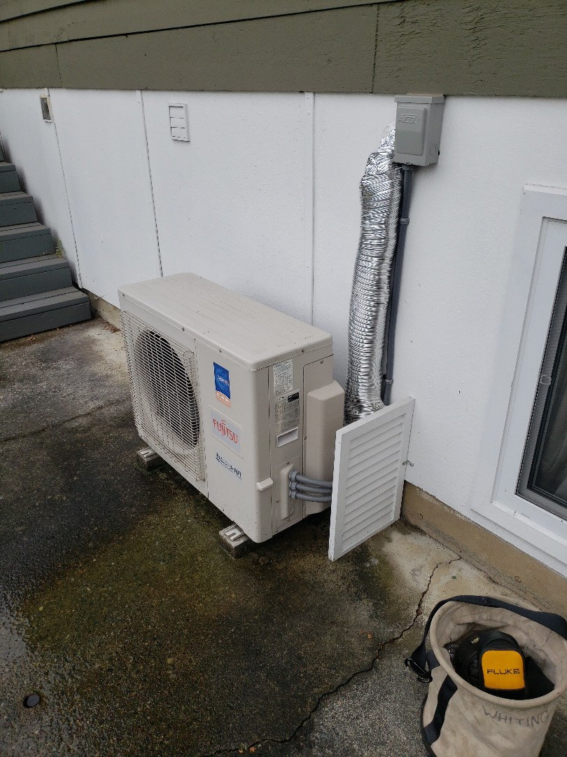 Performing a service on this 2 head Fujitsu mini split heat pump system as part of our Comfort Plan maintenance program!
