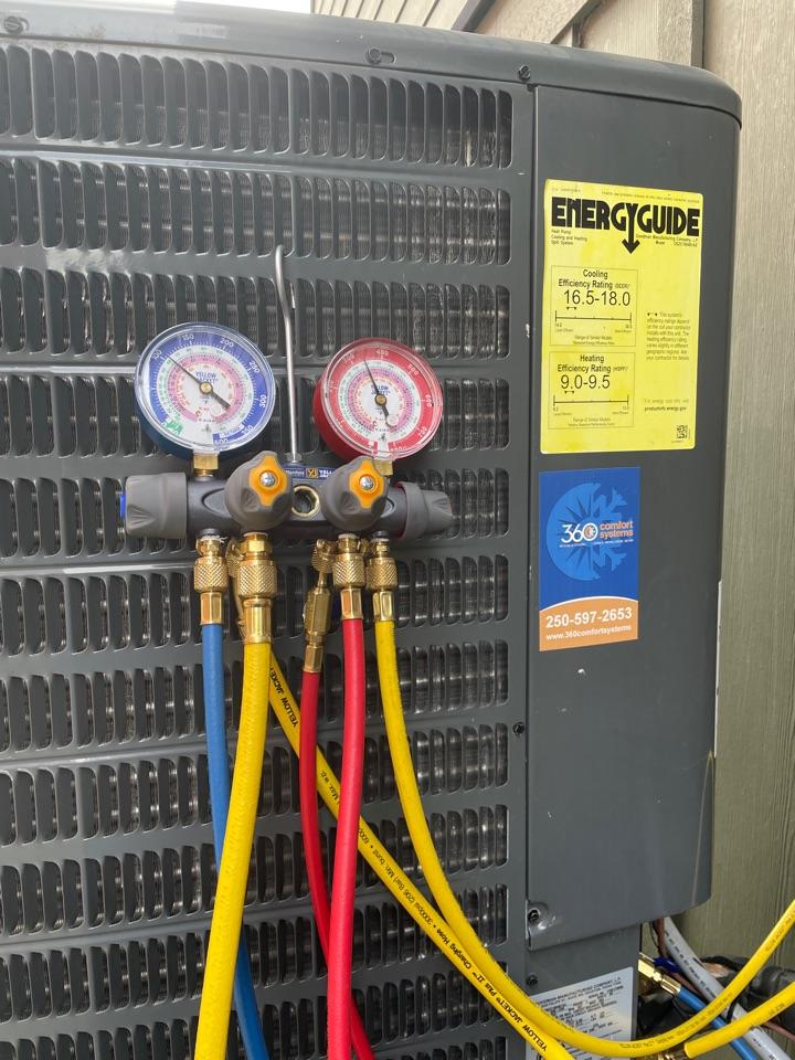 Lake Cowichan, BC - Performing a preventative maintenance check on a 4 ton Goodman heat pump