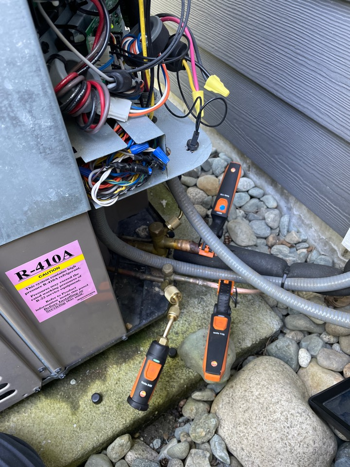 Mill Bay, BC - Performing a preventative maintenance check on a York heat pump