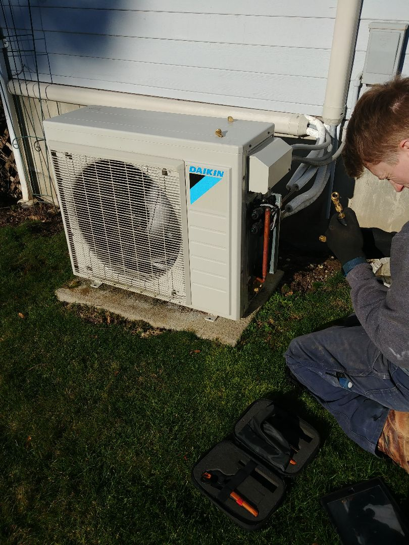 Duncan, BC - Performing a preventative maintenance on a high efficiency Daikin ductless mini-split.