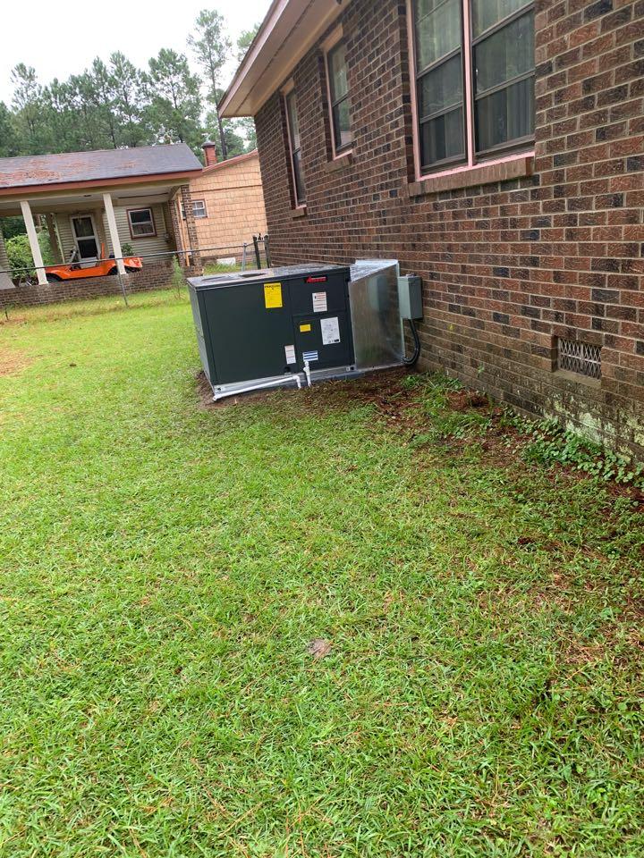 Smithfield, NC - Star new heat pump package unit Amana