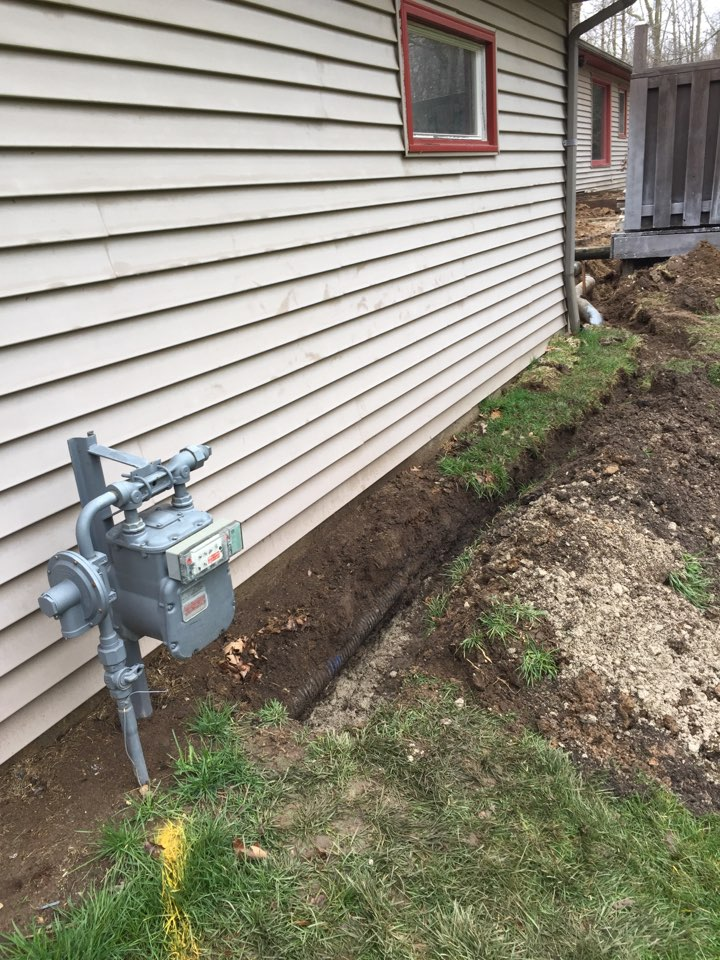 Caledonia, WI - Just adding natural gas pipping to this home. Thank Goodness it's been raining, made this manual labor job a little easier. Lol!
