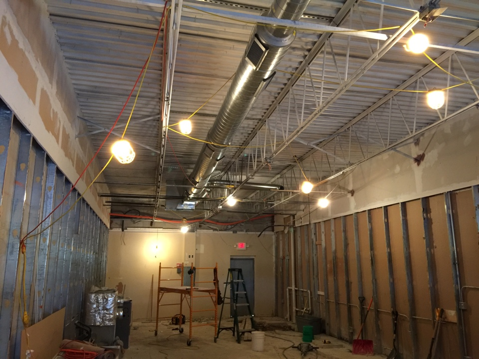 Antioch, IL - Working on a commercial project installing exposed spiral duct!