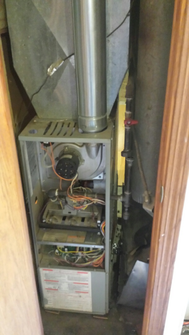 Caledonia, WI - Ripping out this old unit out of a closet