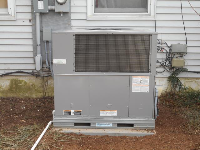 Cleaning and servicing the Heil air conditioning unit with Zep con-coil solution.