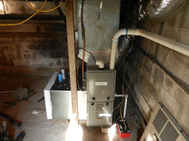 Service work performed for the Heil air conditioning unit with Zep con-coil cleaner.