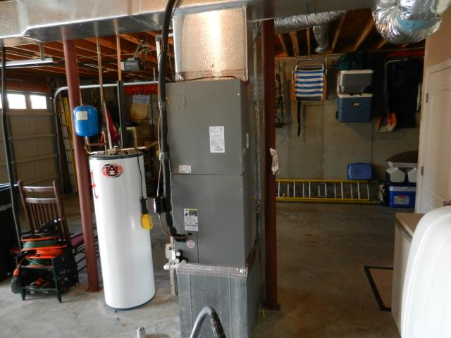 Kimberly, AL - Service work completed for 2011 Heil air conditioning unit with heat pump, cleaned air filters, and adjusted blower motors.