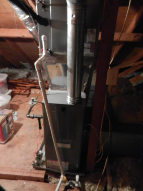 Birmingham, AL - Service work completed for the Heil 2013 package unit with heat pump, checked condensation drain and cleaned condensing coil.