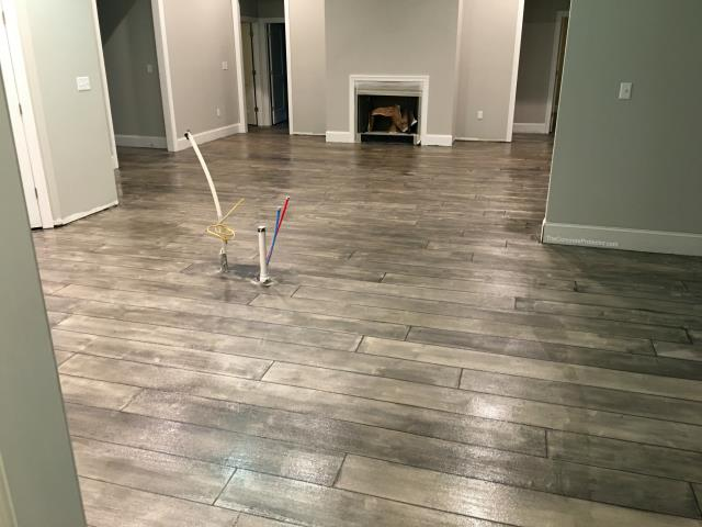 Boise, ID -  Floors that are durable like concrete but look like wood! Start your project today with our help!