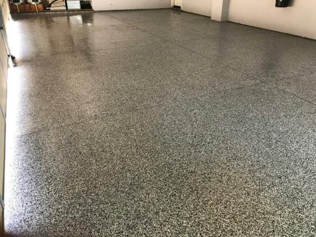 Eagle, ID - Just look at that beautiful floor! Xtreme Epoxy Idaho did a fantastic job coating our concrete basement floor! It's decorative and durable!! Who could ask for a better coating system for a basement than this one!  I highly recommend Jeremy and his crew for all your decorative concrete needs! Great quality flooring for a fair price!
