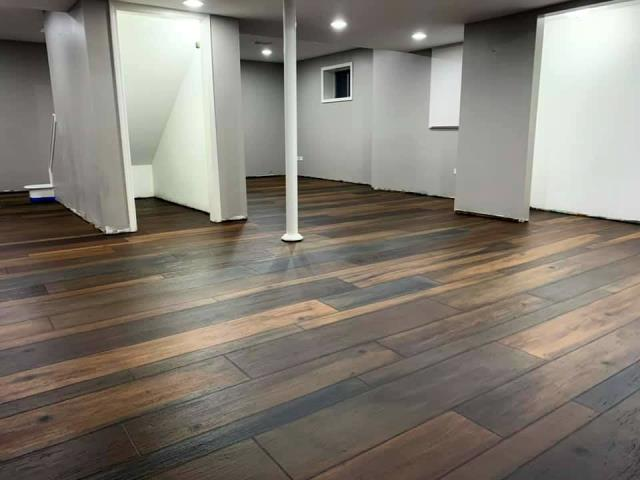 McCall, ID - Love the way this floor turned out! Extreme Epoxy Idaho knows how to get the wood just right so that it looks natural and beautiful! The decorative wood floor makes for a perfect loft to bring guests for a high-class but casual hang-out, couldn't be more pleased!
