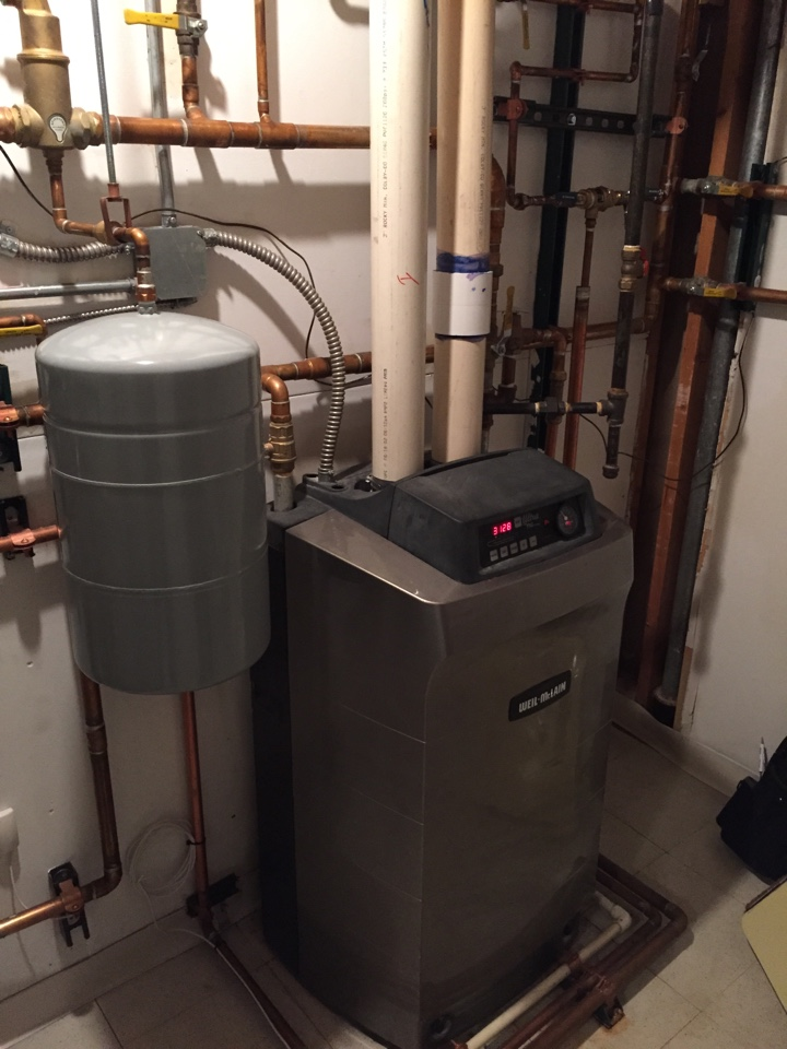 Denver, CO - Weil McLain Ultra boiler service. Replaced zone valve and purged noisy air from lines.