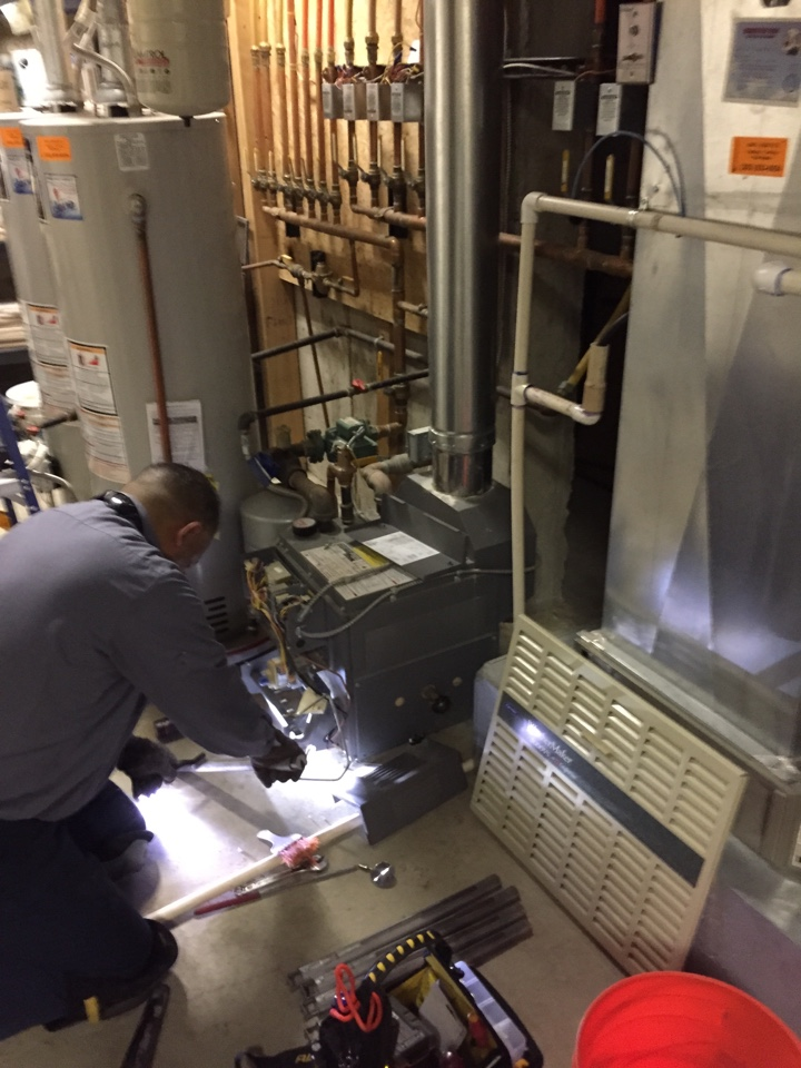 Sedalia, CO - Castle Pines area; deep cleaning of Teledyne Laars boiler. This one filled the home with CO, carbon monoxide, because the previous owners did not have it serviced. Gold Club maintenance to the rescue. That's our new super tech Jose.