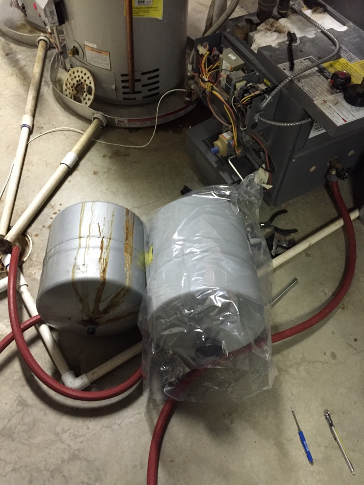 Sedalia, CO - Teledyne Laars boiler part II. Replace leaking air vent, failed zone valve and undersized, rusted expansion tank. This is a large home with radiant heating, a larger tank is needed.