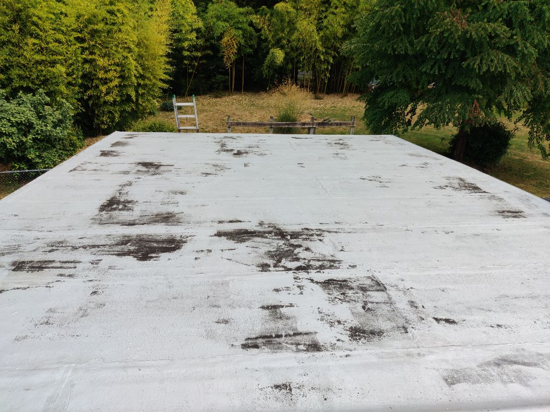 Renton, WA - Bidding a torch down roof to re-coat with aluminum roof coating to prolong the roofs life.
