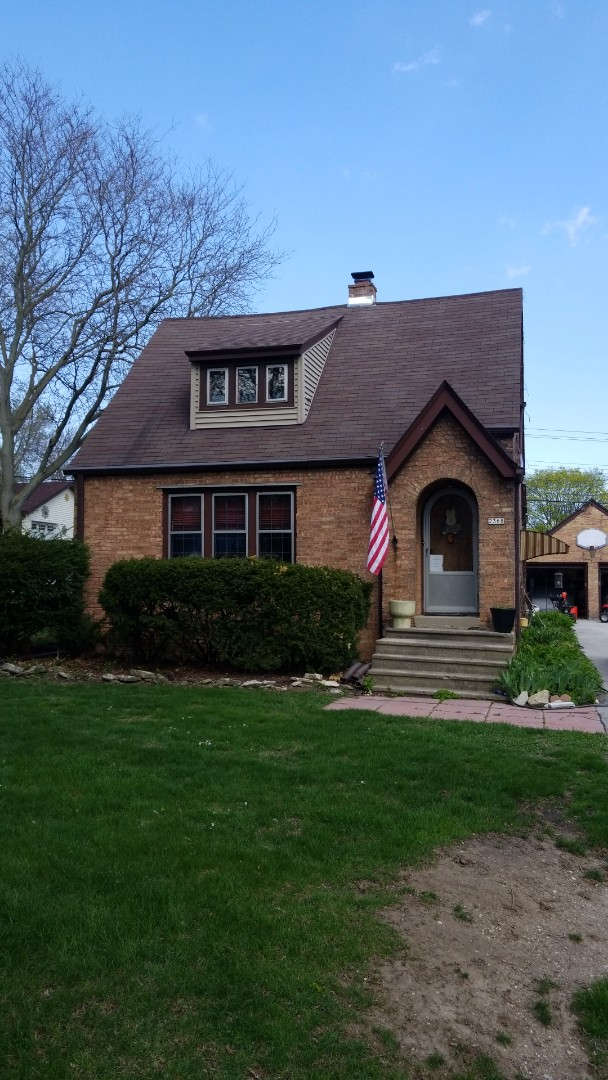 Wauwatosa, WI - Roof repair on residential home including chimney repair and chimney fishing, install roof vent and GAF Ridge Vent. Other roof repairs on house near Milwaukee, WI.
