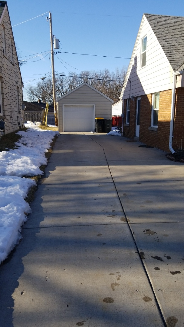 Wauwatosa, WI - Furnish & install GAF residential roofing with complete Weather Stopper asphalt shingle system on garage roof in Wauwatosa, WI.