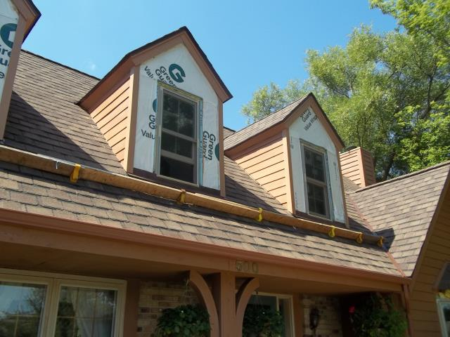 Pewaukee, WI - Furnish and install new Lifetime Residential Roofing system on residential home near me in Pewaukee, WI. Includes GAF Lifetime roofing system, new aluminum seamless gutter system, synthetic underlayment and professional installation.