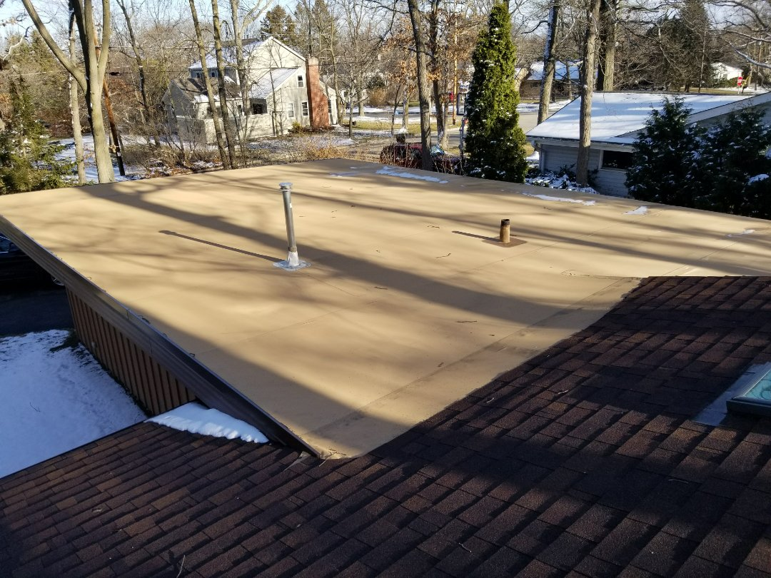 Wauwatosa, WI - New roof on residential home. Work includes shingle roof and Duro Last roof of flat roof
