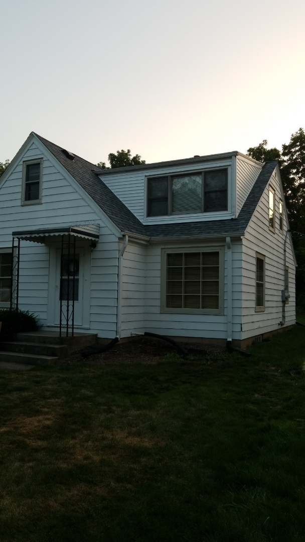 Wauwatosa, WI - New roof on front of house with new siding on upper dormer
