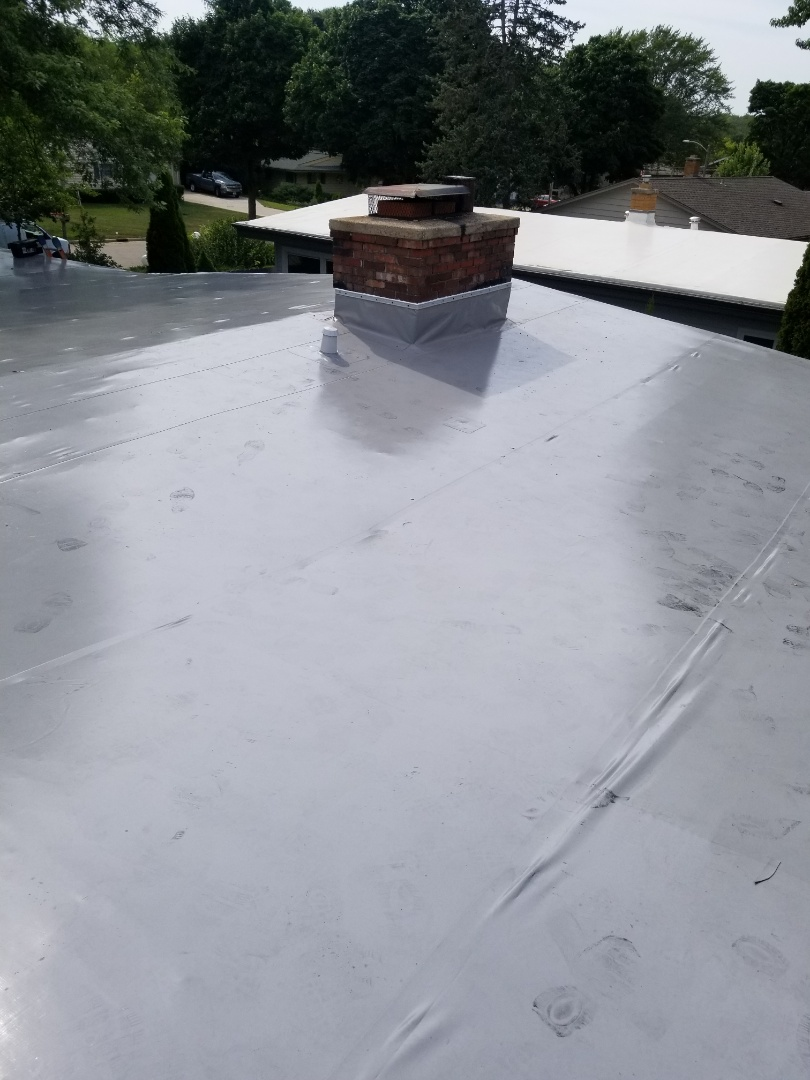 Wauwatosa, WI - New Duro Last PVC membrane roof on California Ranch home in Wauwatosa