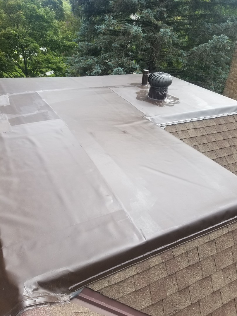Wauwatosa, WI - New Duro-last PVC roof on upper 3rd story residential in Wauwatosa.
