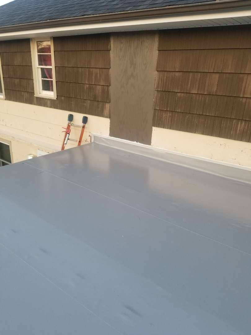 Milwaukee, WI - New Duro-last roof on upper porch on residential home in Milwaukee, WI